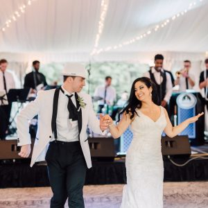 Couple's first dance at their wedding with Central City Orchestra plays in the background