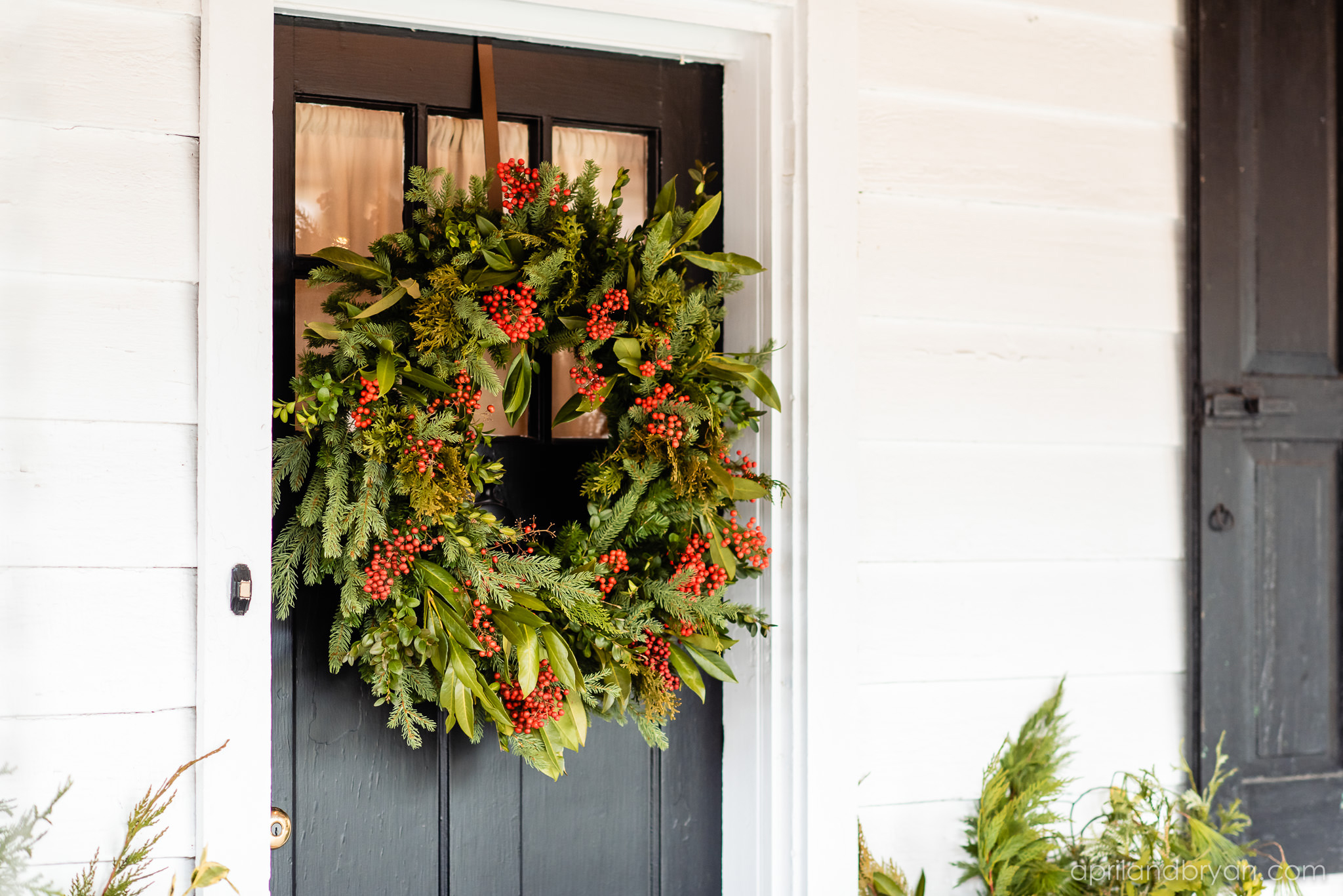 A green wreath adorns the door of the couple's Mount Joy home. Hannah and Ethan Farrell had their classic romantic styled wedding held at their home in Mount Joy, followed by a reception at the catacombs underneath Bube's Brewery. Photographed by April & Bryan Photography, the couple had the opportunity to showcase their early 1900s style and accommodate a small guest list. Featured on Dream Weddings.
