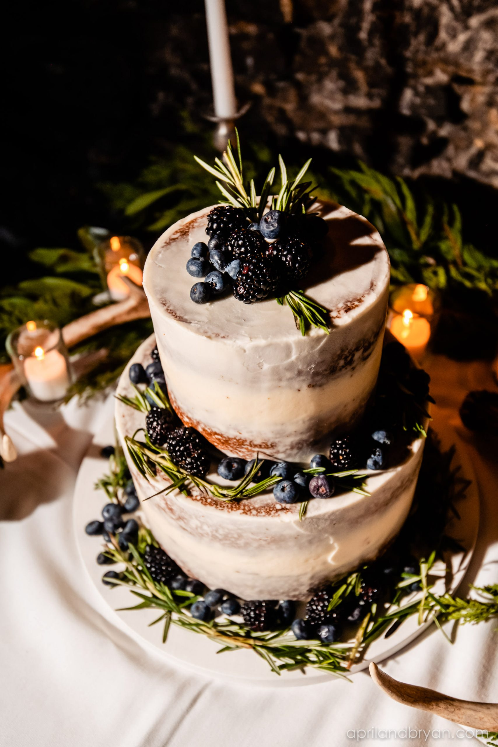 A barely naked cake tied in with the theme and garnished with berries and pine add that special touch. Hannah and Ethan Farrell had their classic romantic styled wedding held at their home in Mount Joy, followed by a reception at the catacombs underneath Bube's Brewery. Photographed by April & Bryan Photography, the couple had the opportunity to showcase their early 1900s style and accommodate a small guest list. Featured on Dream Weddings.