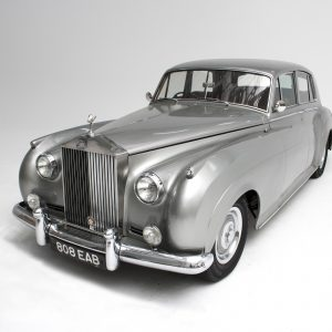 A silver classic car