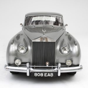 The front of a classic silver car