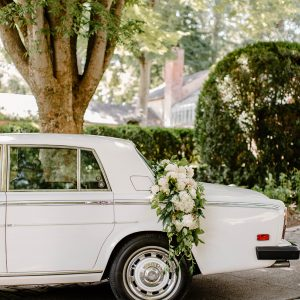 Classic car with flower garland on the trunk