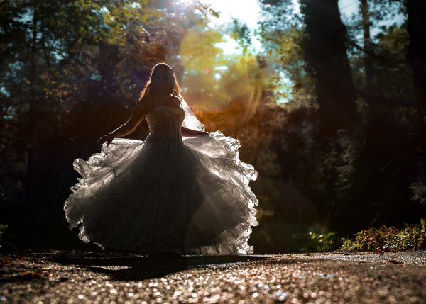 A bride twirling in her large wedding dress